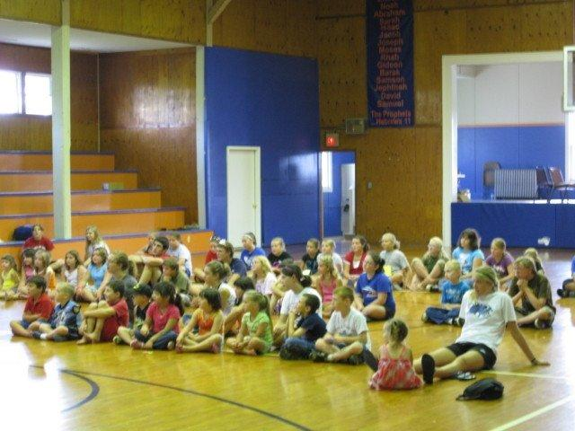 camp group open listening in the gym